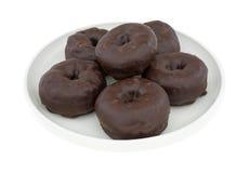 Малый шоколад заморозил donuts на плите Стоковая Фотография RF