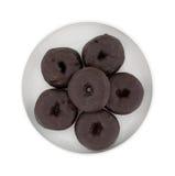 Малый шоколад заморозил donuts на плите Стоковое Изображение
