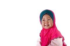 Малыш девушки улыбки азиатский с изолированной предпосылкой Стоковое Изображение