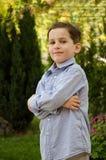 мальчика вне дома Стоковые Фотографии RF
