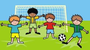 Мальчики и футбол Стоковая Фотография