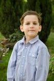 Мальчик вне дома Стоковое Изображение