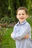 Мальчик вне дома Стоковые Изображения