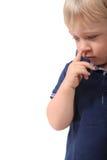 Мальчик выбирая его нос Стоковое Фото