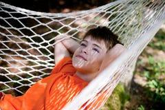 Мальчик в гамаке Стоковая Фотография