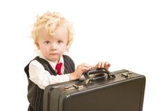 Мальчик в костюме жилета и связь с портфелем на белизне Стоковое фото RF