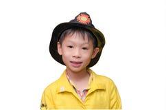 Мальчик в форме пожарного Стоковые Изображения RF