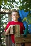 Мальчик в форте дерева Стоковые Изображения