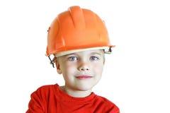 Мальчик в шлеме конструкции Стоковое Изображение