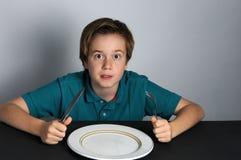 мальчик голодный Стоковая Фотография RF