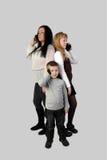 Мальчик, девушка и взрослая женщина с smartphones Стоковые Изображения