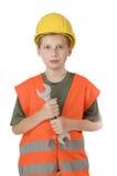 Мальчик держа гаечный ключ на белизне Стоковое Фото