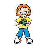 Мальчик держа глобус Стоковые Изображения