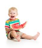 Мальчик есть изолированный арбуз Стоковые Изображения RF