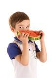 Мальчик есть изолированный арбуз Стоковые Фотографии RF