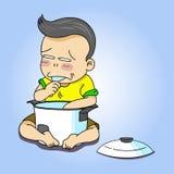 Мальчик ест рис Стоковое Изображение