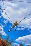 Мальчик летает против скачки неба Стоковые Фотографии RF