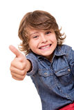 Мальчик делая большие пальцы руки вверх стоковое изображение