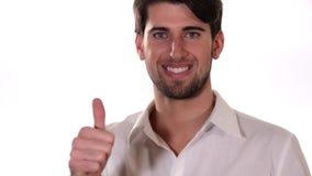 Мальчик делая большой палец руки-вверх подписывает сверх белую предпосылку видеоматериал