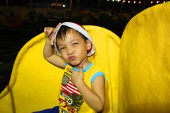 Мальчик делая милое представление Стоковое Фото
