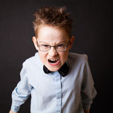 Мальчик делая сердитую сторону Стоковое Изображение