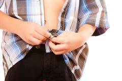Мальчик застегивая на рубашке, изолированной на белизне Стоковая Фотография RF