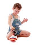Мальчик играя как верхняя часть Стоковые Изображения