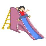 Мальчик играя на шарже скольжения Стоковые Фото
