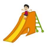 Мальчик играя на шарже скольжения Стоковое фото RF