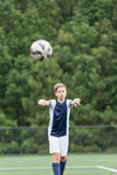 Мальчик играя футбол - принимающ ход внутри Стоковые Фото