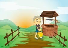 Мальчик и водяная скважина Стоковые Фото