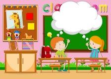Мальчик и девушка в классе Стоковая Фотография