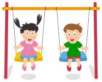 Мальчик и девушка играя на качании Стоковые Фотографии RF