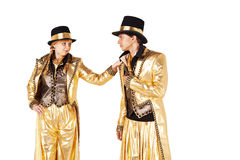 Мальчик и девушка на ходулях одели в золоте Стоковое Изображение