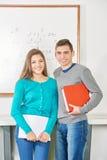 Мальчик и девушка на школе Стоковое Изображение RF
