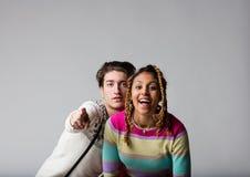 Мальчик и девушка представляя во время партии Стоковое Изображение RF
