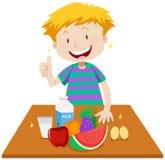 Мальчик и здоровая еда на таблице иллюстрация штока