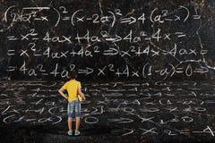 Мальчик и математики Стоковое Изображение