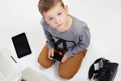 Мальчик и новая технология Стоковое Изображение