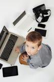 Мальчик и новая технология Стоковые Изображения RF