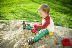 Мальчик и песок Стоковое фото RF