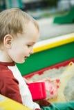 Мальчик и песок Стоковое Изображение RF
