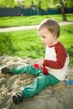 Мальчик и песок Стоковая Фотография