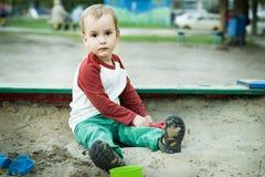 Мальчик и песок Стоковые Фотографии RF