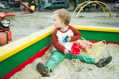 Мальчик и песок Стоковая Фотография RF