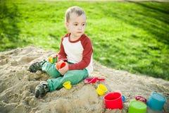 Мальчик и песок Стоковое Изображение