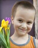 Мальчик и тюльпаны Стоковые Фото