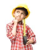 Мальчик как рабочий-строитель с рулеткой Стоковое Фото