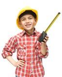 Мальчик как рабочий-строитель с рулеткой Стоковые Изображения