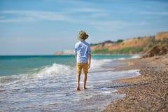 Мальчик моды на пляже Стоковое Изображение
